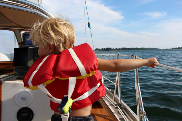 """Cove Henry Holloway aboard Tiny Bubbles II. """"The boys think it's neat to take your house with you when you move around."""" As part of the Casco Bay Stories Project, Heidi and Josh Holloway share their story about living on a sailboat with two young children in Casco Bay."""